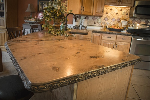 An old-world style concrete countertop in a kitchen.