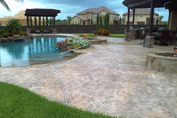 Expansive pool deck with stamped and stained concrete.