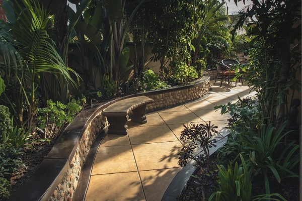 Walkway that is stamped and stained to and feels like a jungle with the perfectly chosen landscaping.