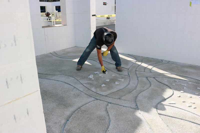 Carving concrete at decorative concrete live.