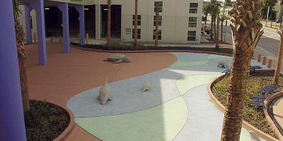 This walkway in Florida was created with integral color. The integral colors used are Cranberry, Marina Green and Powder Blue, which were originally produced by QC Construction Products.