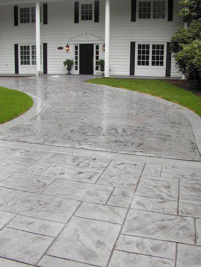 Stamped and sealed concrete driveway brings the guests to this mansion right to the front door.