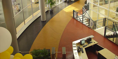 Concrete floor with radials of concrete in black, yellow and red.