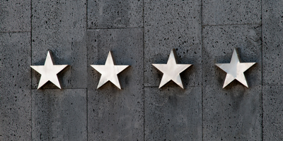 Four stars on a concrete background.
