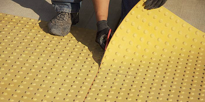 The mats bond to concrete surfaces to avoid moisture underneath as well as potentially hazardous separation between the system and the concrete