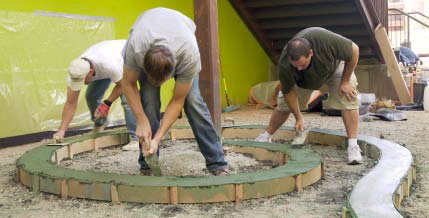 Attendees place concrete once the forms are set to create a beautiful concrete courtyard