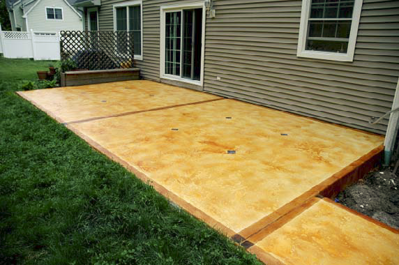 Outdoor patio that has been stained and sealed by Custom Concrete Solutions.
