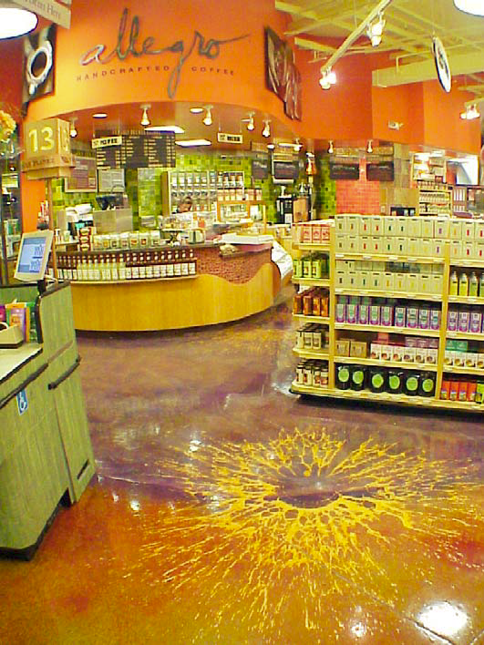 At Whole Foods Market, San Mateo, Calif. Three balloons dropped … no mop required! The rust foreground is dye and patina stain over gray concrete. The purple that defines the store's coffee area is dye and tint over stained, integrally colored Sgraffito overlay. One balloon of yellow Sgraffito was dropped to create the pattern in the foreground. Two balloons, orange over yellow, were dropped near the counter in the background.