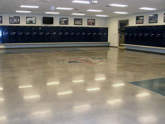 they started with 80-grit metal diamonds. When they reached the 400-grit level, ACCI dyed the floors using Midnight Black and Patriot Blue colors from AmeriPolish.