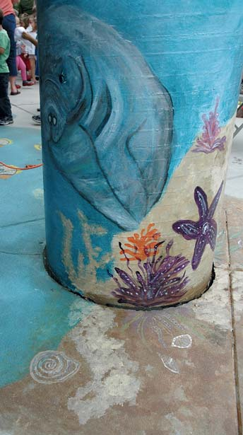 Ocean scene on a concrete post using water based acid stains.