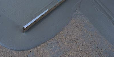 Self-leveling concrete by design is meant to be poured or pumped onto a surface, and the slurry seeks its own level or moves out on its own without a lot of labor on the contractor's end.