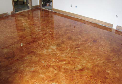 Metallic epoxy coated floor in rich amber and gold.