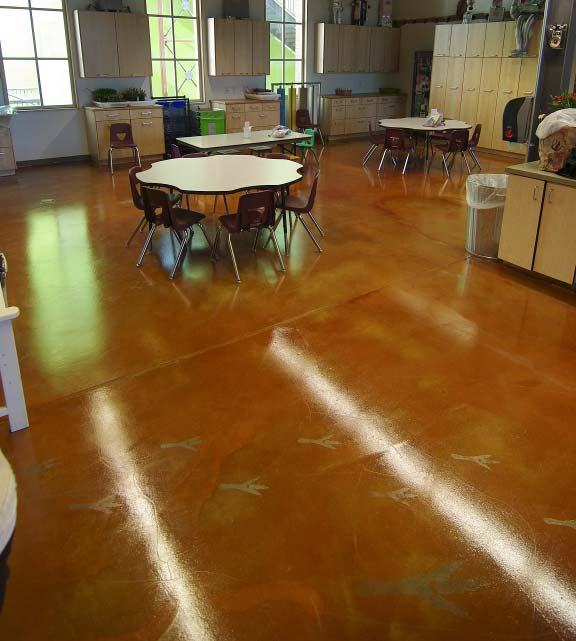 The team got to work the Monday following the Show. They abraded the entire floor, patching holes with Meadow- Patch T2. They applied Rezi-Weld LV, a W.R. Meadows epoxy bonding agent, for primer, then hand-scattered 16-grit coarse sand from Borders Construction Specialties in Phoenix for bonding.