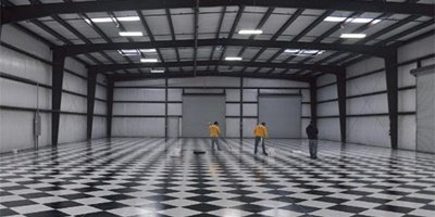 A checkerboard-patterned floor was a natural choice for sprucing up the private garage of a racing enthusiast.