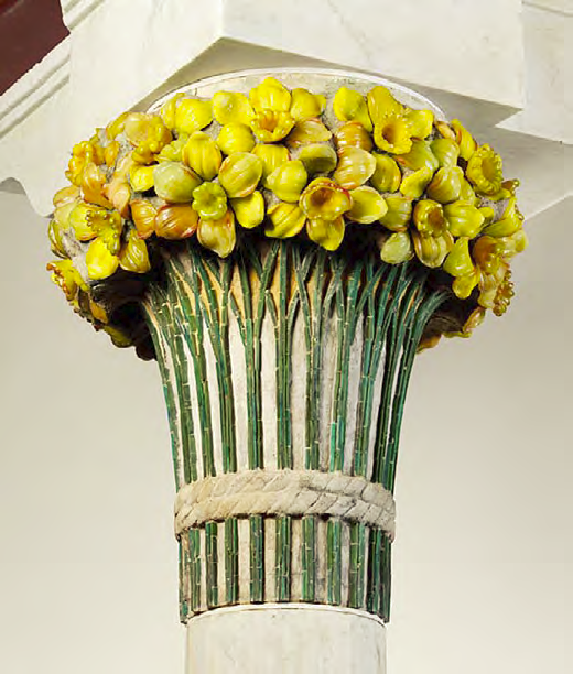 The Daffodil Terrace was named after floral column capitals featuring daffodils in embedded cast and cut glass, in precast natural gray concrete.