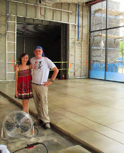 Mike Miller, concretist, and his daughter, field biologist Karley Miller, preen in front of the finished (not so much as a single crack … that's not like him!) Daffodil Terrace slab.