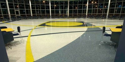 Inspired by the rotors of the helicopters the client manufactures, this intricate, precise design shows off not only the contractor's technical aptitude but also terrazzo's design versatility.