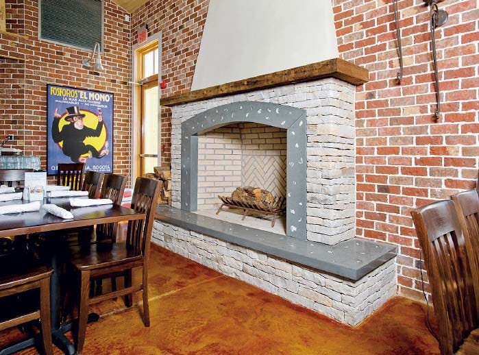 A faux brick fireplace that has been stamped, stenciled and carved for the desired old-world look.