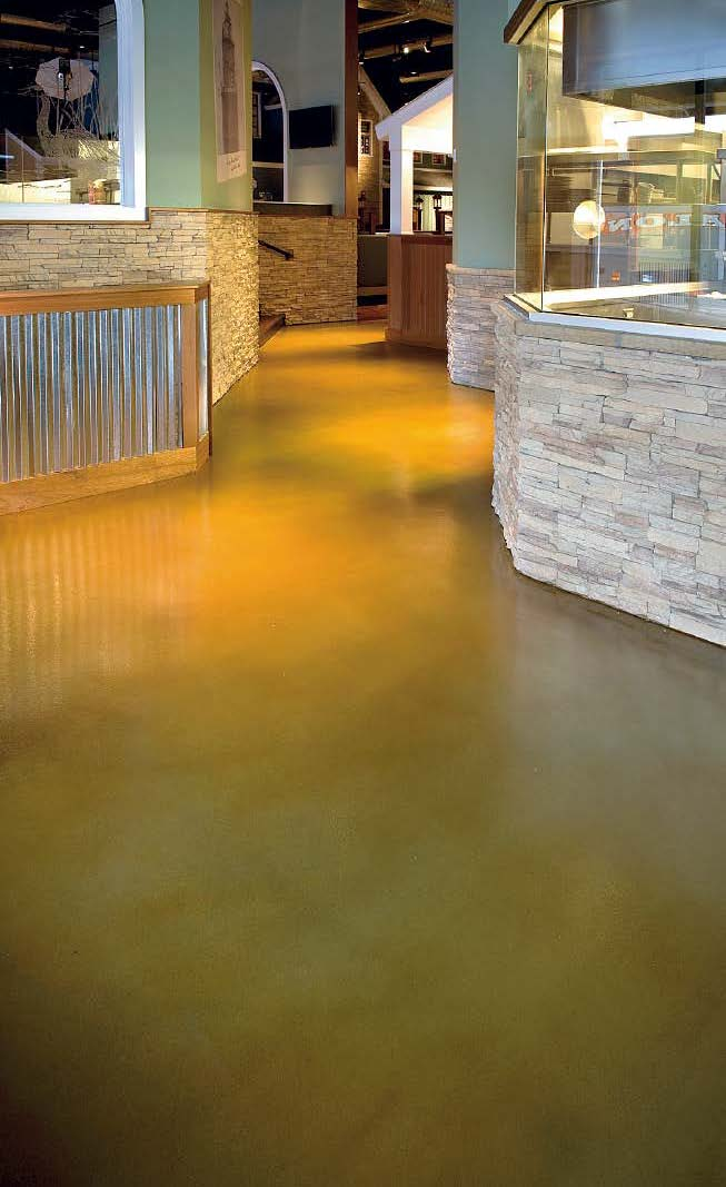 A yellow stained concrete floor that gives a clean look to the space.