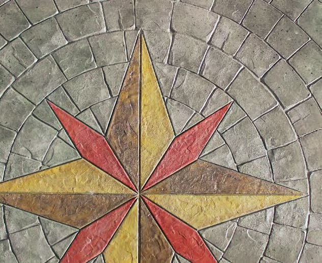 A radial stamp has been placed around a compass rose design in red and yellow.