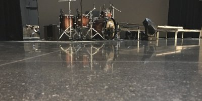 Polished Concrete floor high gloss reflecting a drumset.