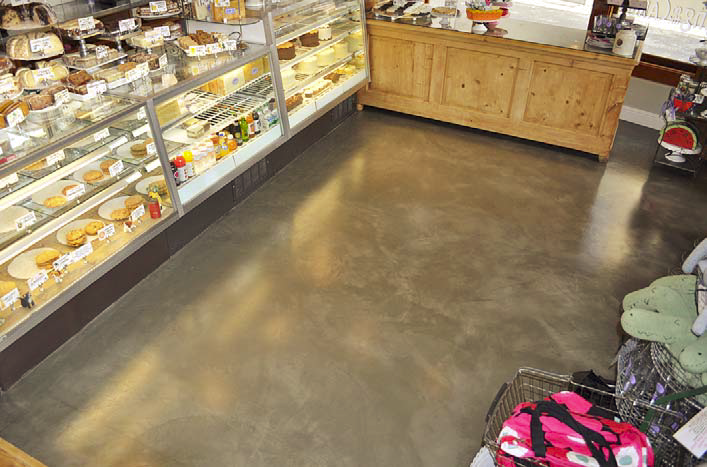 A simple, clean gray concrete epoxy in the floor of this bakery.
