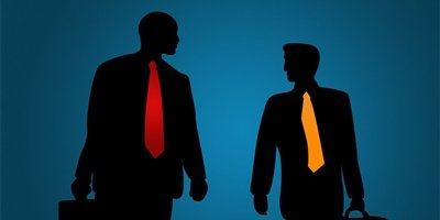 Silhouette of two businessmen with brightly colored ties in orange and red.