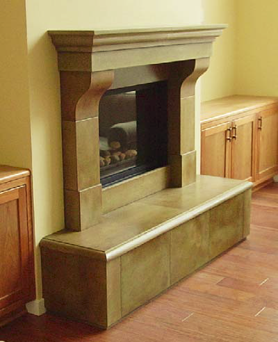 A concrete fireplace adds an elegant feel to this room.