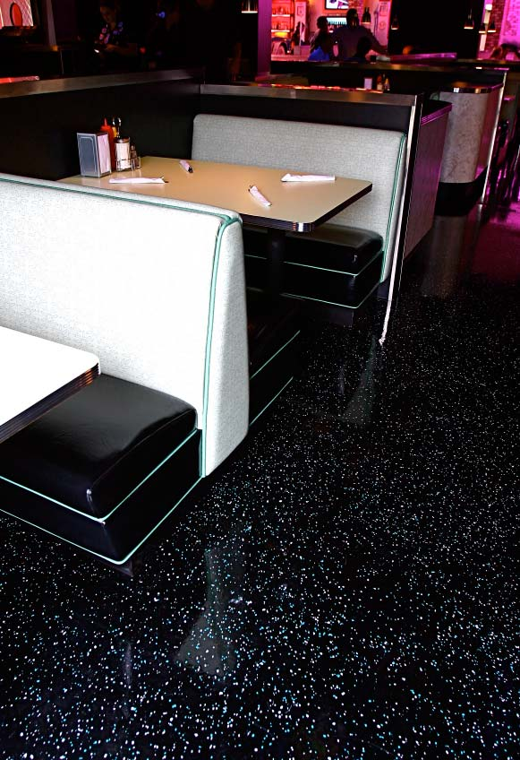 1950s style diner sporting shiny epoxy floors in pink, black and white.