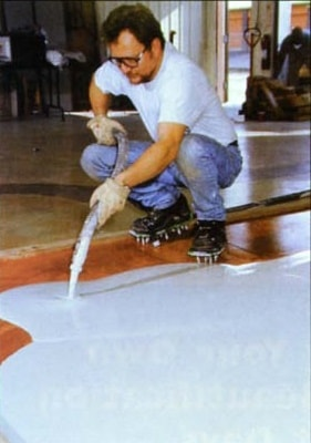 Properly cleaning existing substrate prior to installing a concrete overly.