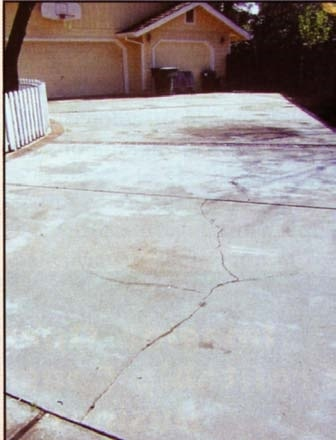 Using a concrete overlay over a cracked slab may not hide the crack for long.