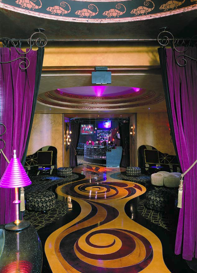 Swanky lounge accented with purples gives life to engraved and colored concrete.