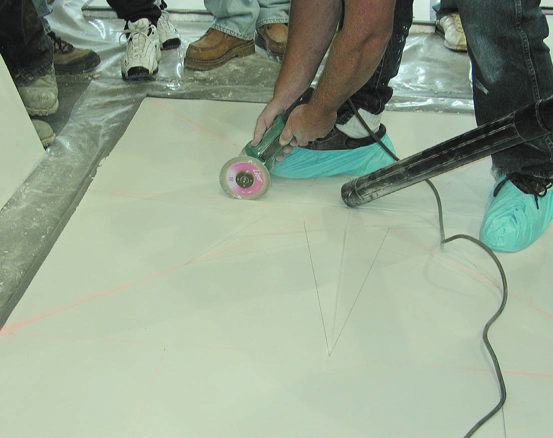 Keeping your workspace clean is vital when engraving concrete, by using vacuums to follow the engraving tool.