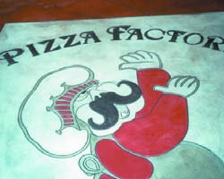 Engraving concrete is a good way to brand as this Pizza Factory logo was placed on a floor at a local pizzeria.