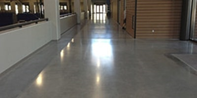 Highly-reflective floor in a main lobby of a building.