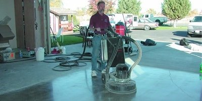 Walk-behind concrete polisher works on the inside of a garage floor to achieve the best look for this project.