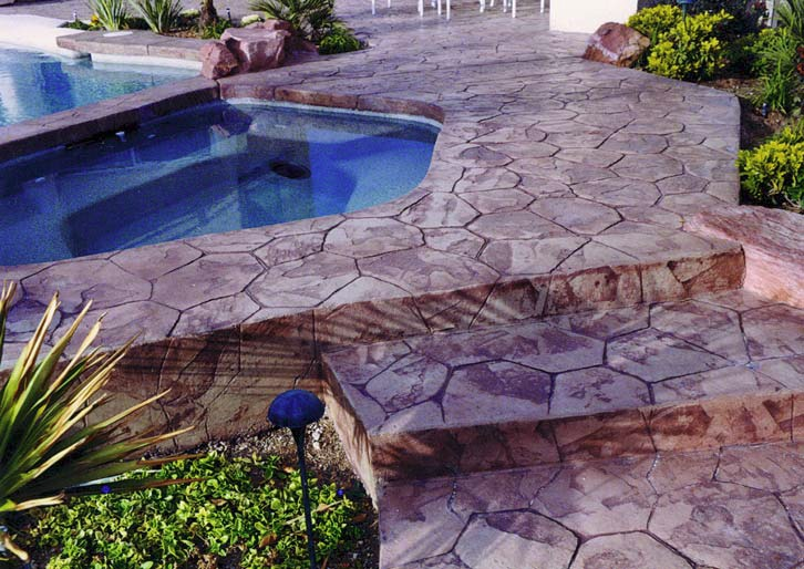 You can fool your audience by creating the best replication of stone that we can by using different shades of the same color in a project as seen here in a pool deck.
