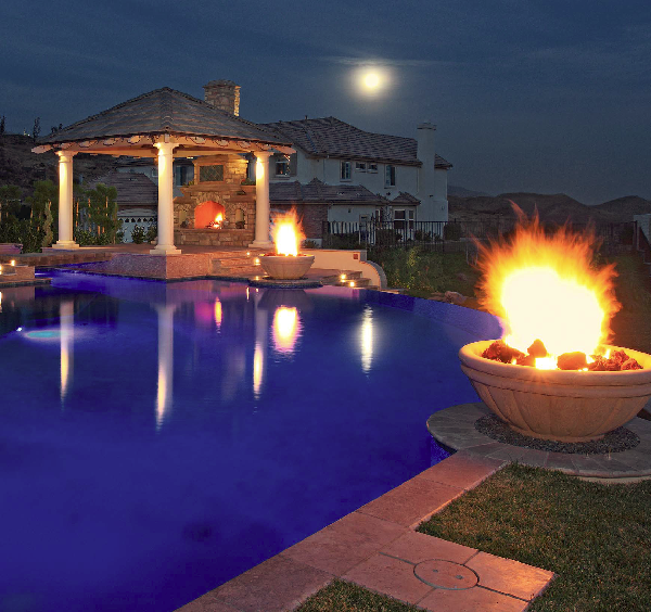 This firepit brings a very dramatic feel to the outdoor space.