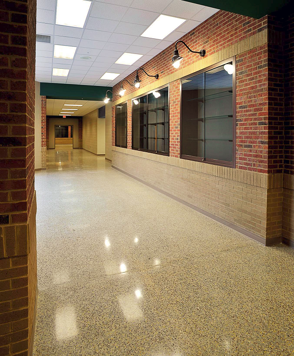 CSolutions polished more than 16,000 square feet at the new Turner Elementary School in Gray, Ga. CSolutions worked with architects to develop a custom blend of aggregate, which was broadcast by hand and floated into the finished concrete slab.