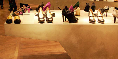 High end shoes sit on top of a custom concrete countertop.