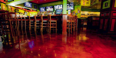 Floor at the Tilted Kilt that has been overlayed and colored after major repairs to the slab were done.