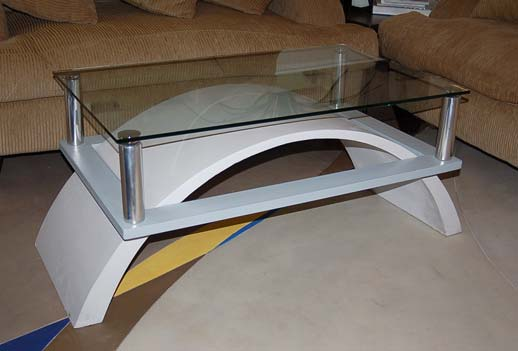 Concrete coffee table half circle leg design glass top and chrome legs.