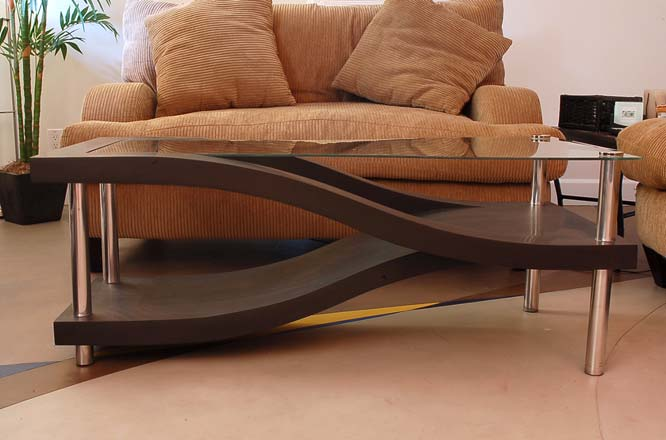 Concrete coffee table with a glass top and elegant angles.