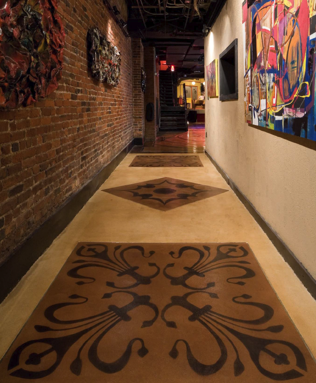 Wide hallway with Elite Crete overlay product stained into whimsical designs.