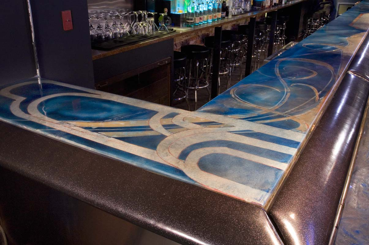 40s design cover this concrete countertop in a tavern in Nashville.