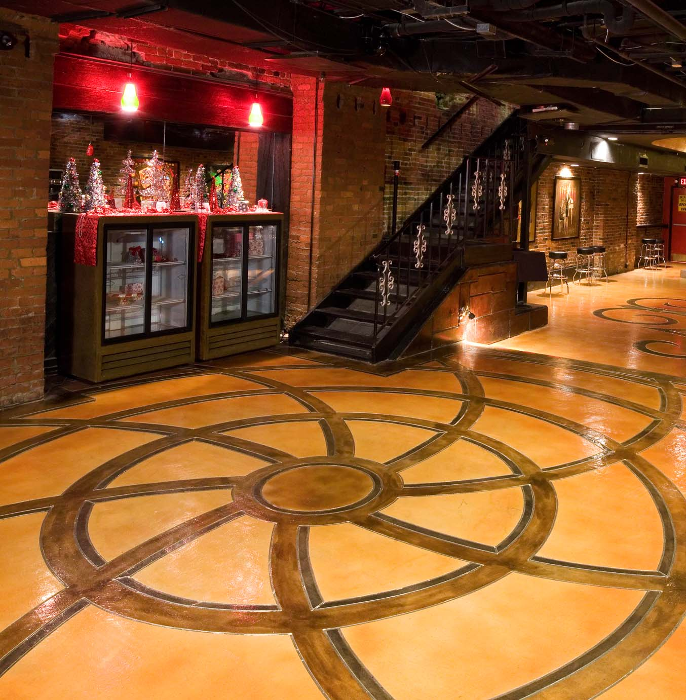 Spiral design on concrete overlay browns and light tan in Nashville.