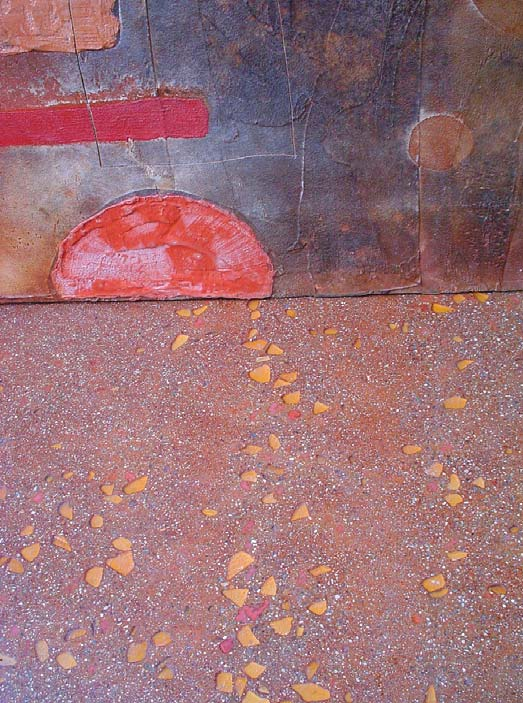 For my floor, I patina-stained over integrally colored gray concrete, which was ground after seeding with crushed brick and tumbled glass.