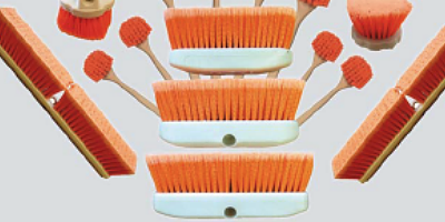 Orange bristled brushes for concrete by Riviera Brush Co.