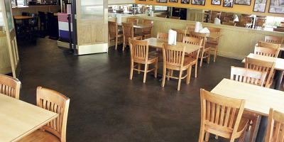 After three years of spilled milkshakes, splattered ketchup and oversquirted mustard, the carpet in the dining area of the Fuddruckers in Modesto, Calif., had to go and was replaced with a stained concrete floor.
