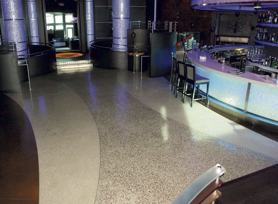 A terrazzo floor in this night club gives it a clean and edgy look.